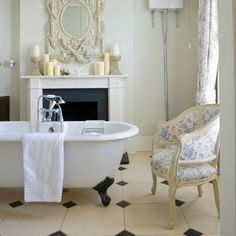 Think about bathroom lighting  'To soften a room use a mix of directional light and easily dimmed spotlights. If space is available, you could also add upholstered furniture. A small sofa, covered in towelling, is ideal or alternatively choose a small chair upholstered in soft linen.'