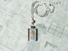 """Bittersweet"" (Version 1) Glass Pendant Necklace with unique bead detailing by turquoiseeye, £12.20 plus shipping. No two pendants are ever the same. All artwork used in my jewellery comes from my personal photography portfolio. I also make personalised hand painted floral jewellery and one of a kind needle felt/fibre jewellery. www.turquoiseeye.etsy.com"