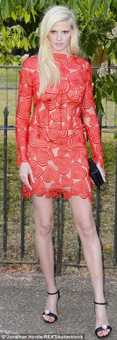 Fierce: Lara Stone was also there and put on a leggy display in a short red mini dress...