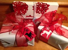 Red and White Gift Wrapping - white paper is the reversed side of a book jacket - Dog Gift Tags are a sihouette of a Black Lab and Italian Greyhound (just google the name of the dog sihouette you want in google image, trace and cut out. http://www.pinterest.com/bethob/wrap-it-up-with-a-little-whimsy/