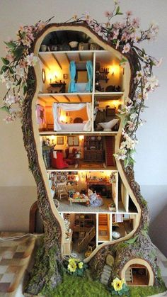 Sometimes we come across something so wonderful, so magical, it truly is indescribable. I would have to place this astounding Miniature Mouse Tree House in that category. There's almost nothing you can say that will do it justice, Read the article and then go her her website to see even more pictures and how she did it.: