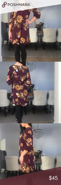 EVERLY make shift plum floral dress Never been word! New with tags! It doesn't fit me any more and would love to sell it! Elastic around the cuff. 100%polyester. I'm 5'9 and it hits my mid thigh! Everly Dresses Mini
