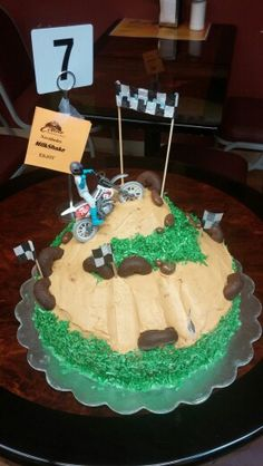 Dirt bike cake ..... Dulce de leche whip cream....