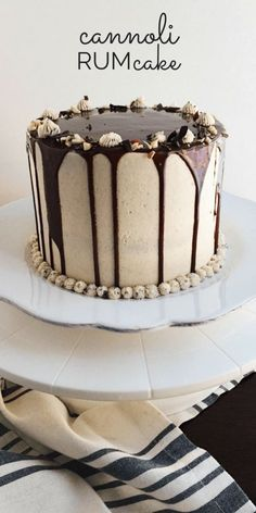 Italian Cannoli Cake is composed of layers of rum-soaked vanilla buttermilk cake, creamy ricotta and mascarpone cannoli filling, rich chocolate ganache, and a cinnamon and citrus kissed buttercream.
