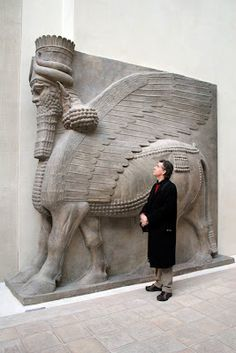 the Lamassu.  The Lamassu were human headed winged bulls, sometimes with the paws of a lion, which were considered guardian figures to the king.