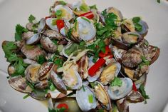 Steamed Little Neck Clams with Beer, Ginger, Cilantro and Lime. omg. delicious!