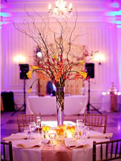 Unexpected Centerpiece Idea: Branches and Small Flowers    Holding a winter wedding means your flower choices will be a little more limited. So it's good to know that you can make a gorgeous centerpiece out of bare branches and a very limited number of flowers.