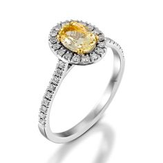 This is a semi mount ring including pave cluster on the band, set with a solitaire gemstone Scapolite and diamonds. The ring is a single gemstone, a natural Scapolite, oval cut, 5x7 mm, color in ranges of light yellow, clarity is eye clean or better, average carat weight is between 0.75-1.00 carat. The diamonds set in the ring paves are 37 round brilliant cut, white color in ranges of F-G, clarity is eye clean in ranges of VS-SI, average carat weight is between 0.35-0.40 carat.(The ring is…