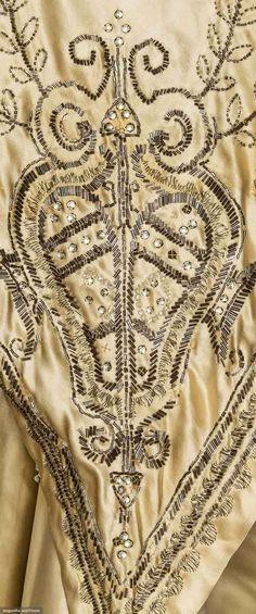 Hobble Skirt Ecru silk satin bodice w/ silver bugle beads & rhinestones, slim skirt w/ side panels of black net embroidered w/ crystal beads, low skirt of beaded ecru satin, skirt B w/ attached narrow train,