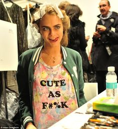 Oh so cool: Cara Delevingne was seen pulling funny faces for the camera backstage ahead of the Issa show at Somerset House on Saturday