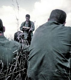 US Army chaplain conducting a service in the field