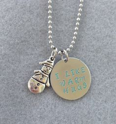 """Frozen Inspired """"I Love Warm Hugs"""" Hand Stamped Aluminum Necklace with Ice Blue Letters"""