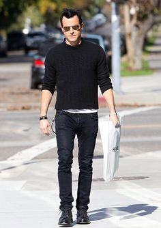 Justin Theroux wore a tight sweater after doing some shopping at Helmut Lang in L.A. Dec. 18.