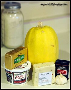 I must be on a cheese kick...see Grain-Free Mac 'n Cheese. Tonight's delish dish is Spaghetti Squash Au Gratin.