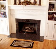Brown granite fireplace surround. Looking for granite products? Contact Universal Stone Inc. today- visit the website at http://www.universalstone-inc.com/.