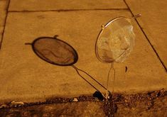 isaac cordal: cement bleak - cast shadow strainer faces