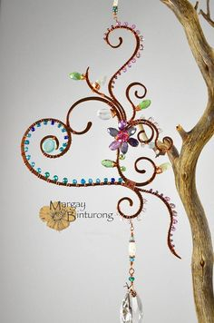 Love sparkly, copper wire art? Come check out the rest of our collection here: https://www.etsy.com/shop/MargayAndBinturong/items?section_id=21415727 Ive FINALLY decided to put my Suncatchers on my etsy page! Please bear with me as I attempt to add photos that will do them justice. Its exceptionally difficult to photograph these in sunlight, but BOY are they absolutely LOADED with sparkly, glittering bits of beauty. I promise you will love it so much hanging...