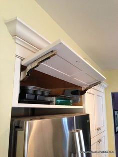 Make it easier to reach above the refrigerator with an uplift door! Via Hamtil Construction: Kitchen Cabinet Storage Solutions on Hometalk.com