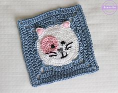 This kitty cat crochet granny square is such a fun and whimsical little project with tons of personality! By changing the colors of the kitty's head and spot, you can make tons of variations of this pattern. Use this square pattern to make a kitty themed blanket or pillow, or just attach it to a gift for your favorite cat lover! It works up rather quickly and is a great advanced beginner project.