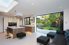 This contemporary flat roof kitchen extension in Wimbledon has provided a bright and spacious kitchen and dining addition. Kitchen Extension Open Plan, House Extension Plans, Roof Extension, Extension Ideas, Open Plan Kitchen Dining Living, Dining Room, Patio Slabs, House Extensions, Roof Design