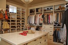 Walk-in organized closet. I love how everything has a place in here. If you put a pad on top of the dresser, it could double as an ironing board, which means you could put things up as soon as you ironed them.