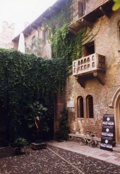 Juliet Capulet's Balcony in Verona, Italy. People come from all over the world to write their love stories and love problems to Juliet and leave them on the wall below her balcony.... I want to visit here one day!