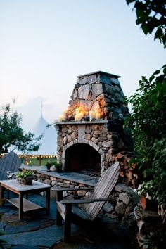 I can't tell you how bad I want one of these! Outside stone fireplace with mantel....