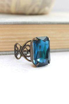 A vintage style dark blue zircon ring
