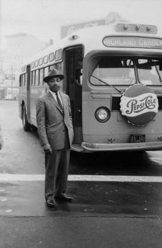 Reverend Martin Luther King, Jr. stands in front of a bus at the end of the Montgomery bus boycott, Montgomery, Alabama, Dec. 26, 1956.