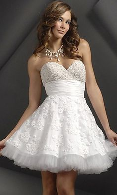 strapless cotton tight fitted top, with a plain white satin belt, and a fancy patterned short cotton bottom dress