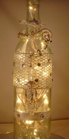 Wine bottle ideas misc on pinterest painted wine for Wine bottle decoration with lights
