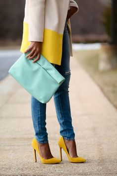 Color blocked yellow and tan coat, eggshell blue clutch purse, bright blue denim, and yellow heels.