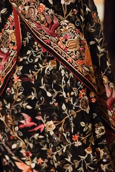 Probably georgette, with thick crewel or aari Kashmiri-type embroidery? (Feel free to comment if you know a different name for this.)