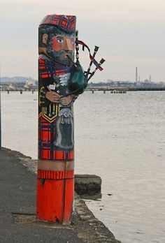 """Geelong, Victoria, Australia - """"Scotsman"""" Bollard No 40 - The early Scottish settlers brought their popular Highland Games to Geelong at which the indigenous people often participated."""
