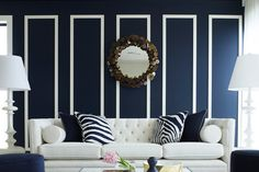 """Conventional decor wisdom says that dark walls make a place look """"smaller."""" We've never been one for rules in the first place, but we admit that occasionally, a dark paint job can make a room feel a bit claustrophobic."""