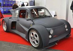 """I'm not a Fiat 500 Man!! But this Fiat 500 by Oemmedi-Meccanica is fitted with a Lamborghini Murcielago 6.2-litre V12 Engine. As things look, """"throwing"""" that engine into one of the smallest production cars ever built was no easy task as the Fiat had to lose its rear seats and needed a complete makeover at the back. The 500 also gained a Lamborghini set of wheels, parts of the supercar's rear fenders and even a working retractable rear wing."""