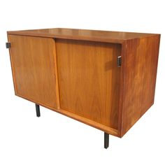 My daddy built a cabinet just like this one to house the hi-fi/stereo set he built himself.  (Florence Knoll   Credenza)