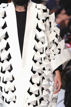 Innovative textiles design for fashion with use of cut, fold and repetition to create pattern and texture - fabric manipulation; surface creation // Henrik Vibskov