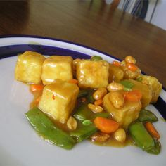 When I get a craving for orange beef, I make up this tofu stir-fry! Pieces of firm tofu in a mildly spicy orange sauce. Serve over rice noodles, and use any vegetables you like! Stir Fry Recipes, Tofu Recipes, Asian Recipes, Cooking Recipes, Ethnic Recipes, Chinese Recipes, Chicken Recipes, Vegetarian Main Meals, Homemade Chinese Food