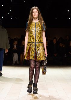 A glossy, panelled shift dress worn with The Buckle Boot and The Patchwork bag. Discover the collection at Burberry.com