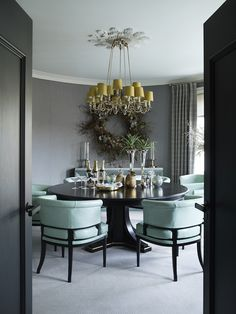 Hubert Zandberg Interiors designed this London pied-à-terre as a contemporary take on a traditional gentleman's club, and in the dining room, pale blue chairs by Soane surround a custom dark-wood table by Zandberg.