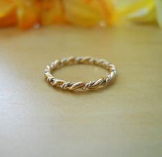 Stacking  Small Twist 14K Gold Filled and 925 Sterling Silver Mixed. $29.00, via Etsy.