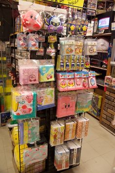 Kirby Goodness at Super Potato in Akihabara, Japan - If someone took me there and showed me that i would fangirl out! I would buy that whole little section of Kirby stuff :)