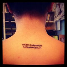"""handmaid's tale - fake latin for """"don't let the bastards grind you down,"""" in her best friend's handwriting"""