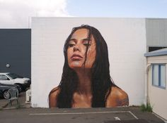 Hyperrealistic street portraits of women in unexpected places by Sean #Yoro aka #Hula.