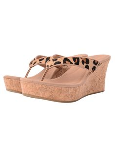 The wedged sandals with cork wedge and leopard print calf hair thong strap are perfect for sunny holiday wear. Pair with matching leopard print cigarette pants or dress or for day beach style wear with a bikini and kaftan