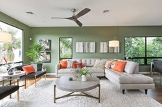 Green living rooms are modern, elegant and stylish. Whether it's adding a lime green accent wall or showcasing a mint green couch, we've rounded up the best green living room designs. Living Room Orange, Accent Walls In Living Room, Living Room Photos, Living Room Color Schemes, Living Room Paint, Living Room Sofa, Interior Design Living Room, Living Room Designs, Living Room Decor Green Walls