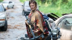 Even in a poncho, I'd trust this man to help me survive a zombie apocalypse.