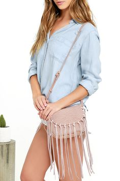 "The odds are always in your favor when you're toting the Favorable Circumstances Blush Fringe Purse! Tumbled faux leather shapes this cute cross-body purse with genuine suede fringe along the front flap. Interior has two side-wall pockets. Adjustable strap measures 48"" at longest adjustment."