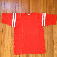 A personal favorite from my Etsy shop https://www.etsy.com/listing/177855459/vintage-orange-white-5050-1970s-football